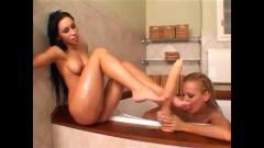 2 girls licking feet