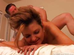 Busty brunette mature babe sucks and fucks a cock.