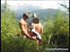 German brunette enjoys a hot outdoor threesome