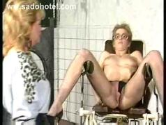 Hot dominatrix spanks horny slave on her ass with a stick and covers her body in hot candle wax