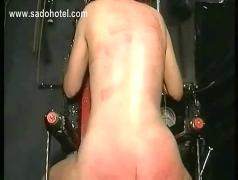Slave with great body tied in a dungeon gets her back covered with hot candle wax