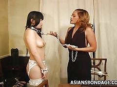 Asian slut is put on a leash