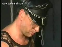 Hot and horny slave sitting in a chair gets her body with hot candle wax by two german masters