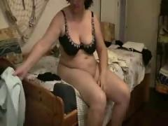 Watch my mom cumming on bed. hidden cam