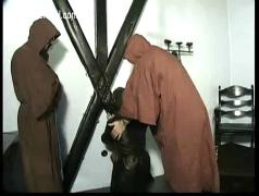 Dungeon full of horny masters ties scared slave to a wall and spanks her on her butt