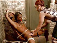Dominant redhead whipping a bonded bitch