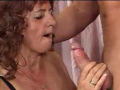 Granny in stockings spreads for cock