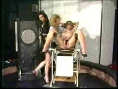 Horny slave got her beautiful body covered in hot candlewax and another slave rubbes it off