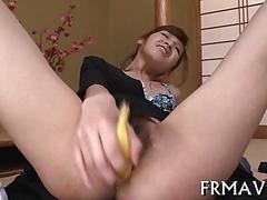 Japanese chick toys her pussy with a banana in close up