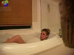Sexy blond girl caught playing with herself in the bath