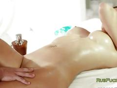 Oiled brunette fucked by masseur