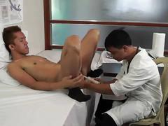 Asian doctor gaping patient's ass