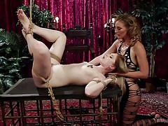 Mistress is in control of her bound female slave