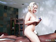 Blonde masseuse gives head to a big black guy
