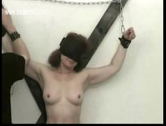 Hot slave with nice tits is spanked on her ass pulled on her nipples and finger fucked