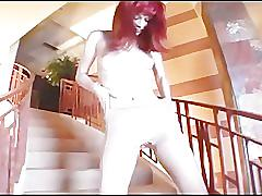 Redhead licking her toes and masturbating in ripped pantyhose