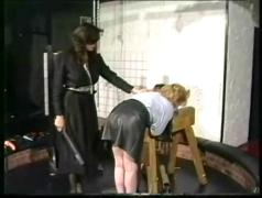 Slave in leather skirt is bend over by horny dominatrix with great body and got spanked on her ass