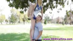 Teen cheerleader tugs on a rod and sucks it