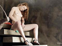 Cute redhead diddles herself on the stairs
