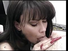Brunette hottie blows cock in the office