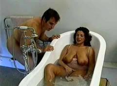 British busty milf gets fucked in the bathroom