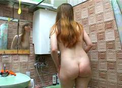 Elena in bathroom