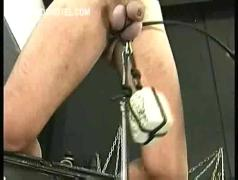 Dirty slave gets rope around his balls with heavy stones and gets his nipples burn with candle