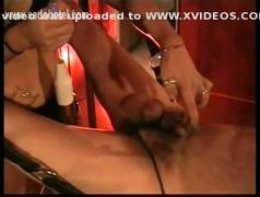 Beautiful mistress with big tits shouts at dirty slave and electroshocks his tied up balls