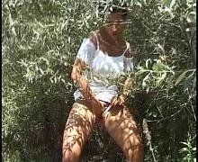 Milf spy on a nude man in beach