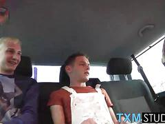 Two twinks sucking big cock in the backseat