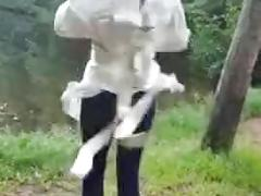 Girl in a straight jacket in the woods