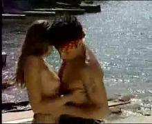 German couple having sex at beach