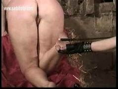 Master hits blind folded slave on her ass with a whip and spanks her under her feets