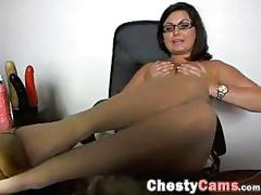Busty brunette gets naked in front of webcam