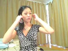 Cute asian girl fingering on her webcam