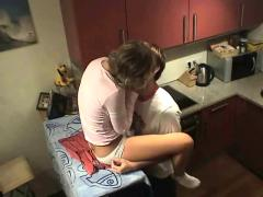 Teen couple having sex while ironing