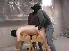 Stud gets spanked and fucked by two dudes