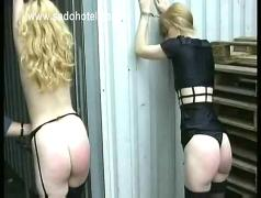 Two beautiful blond slave tied in wharehouse gets spanked on nice butts by two masters bdsm