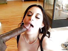 A black cock matches her dark hair