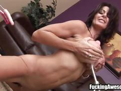 Busty milf double penetrated by a fucking machine