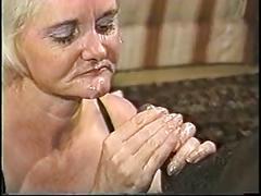 Blonde mature granny in lingerie loves sucking on a big hard black dick