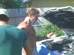 Hot muscled mechanic pumping horny young hunky customer outdoors