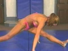 Topless female wrestling with fitness models