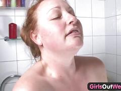 Hairy busty amateur plumper rubs one out in the bathroom