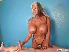 Mature masseuse handjob