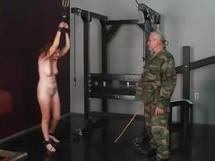 Cute young shaved pussy brunette slave girl is caned and spanked by master