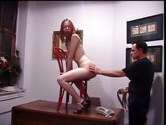 Cute redhead bent-over and spanked by her master