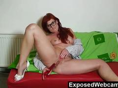 Sexy redhead babe toying her shaved tight cunt.