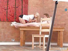 Blonde slut giving head to a guy on the table