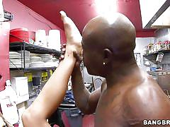 Black stud fucking a woman in a kitchen